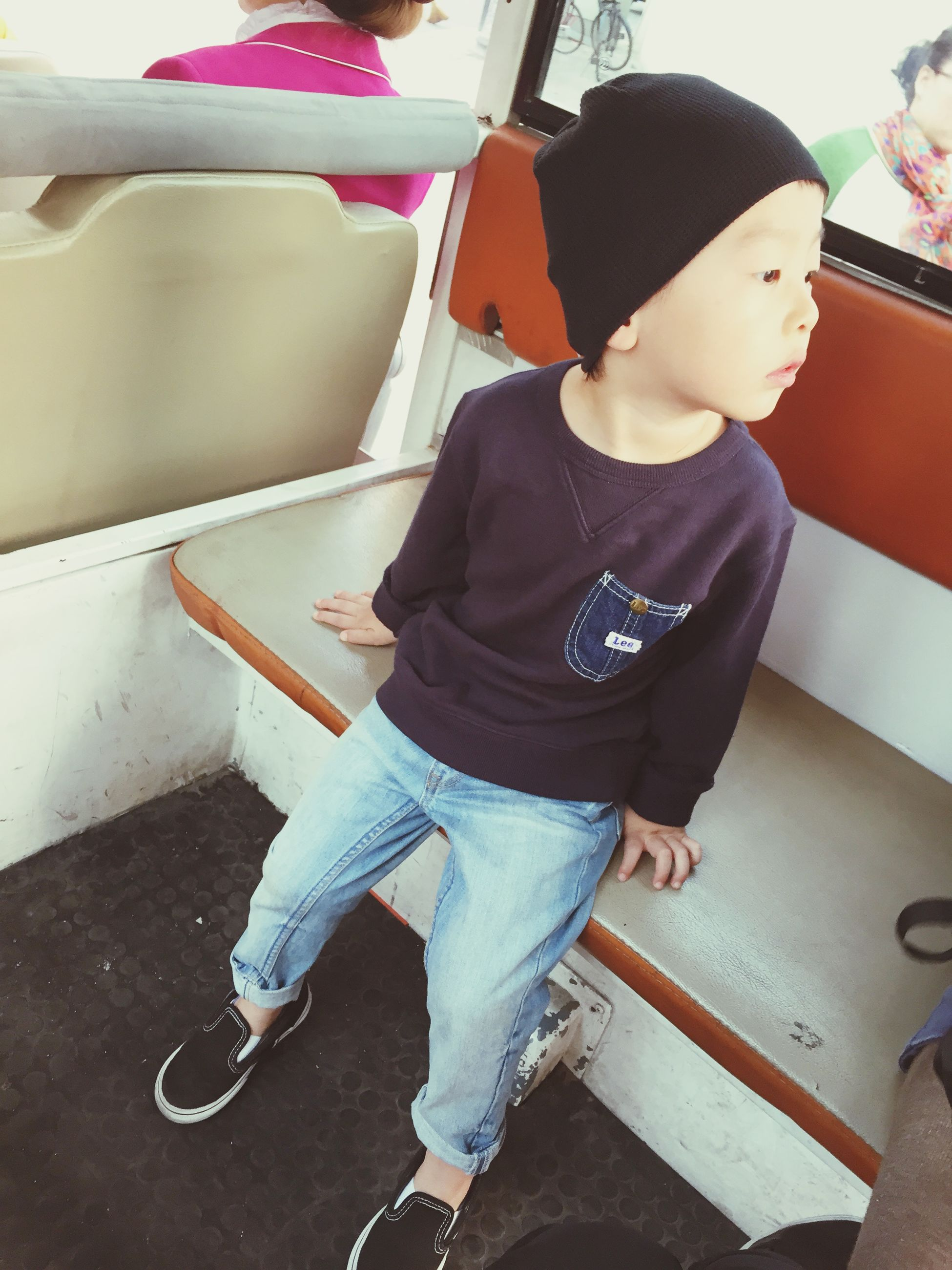 casual clothing, person, lifestyles, full length, indoors, young adult, front view, standing, leisure activity, three quarter length, looking at camera, holding, childhood, portrait, sitting, young men, high angle view