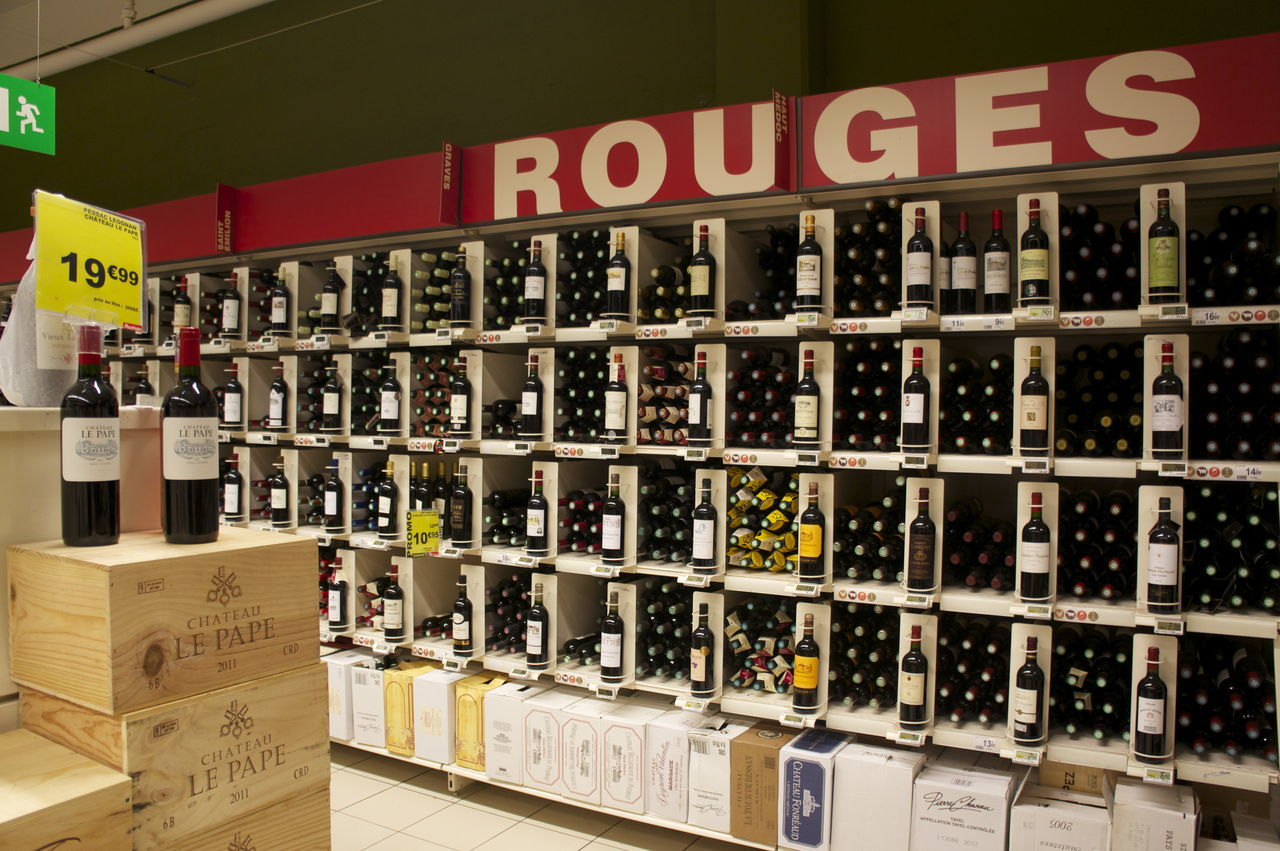 Red rouge stall in supermarket Arrangement French French Wine In A Row Market Market Stall Red Wine Shelf Shop Store Variation Wine