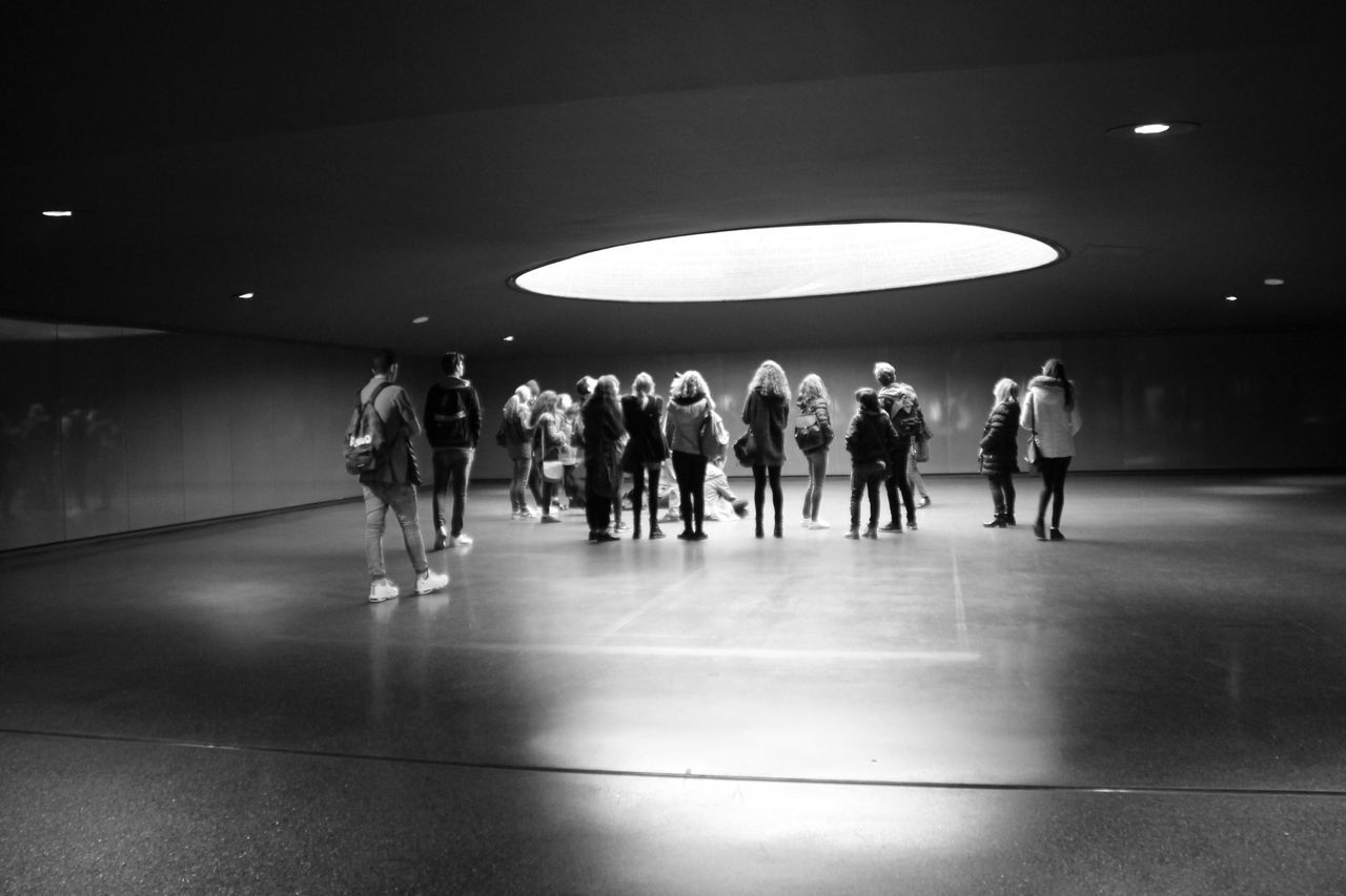 Real People Illuminated Lifestyles Leisure Activity Lighting Equipment Indoors  Men Large Group Of People Full Length Women Day Taking Photos Standing Togetherness Young Adult Atocha Memorial Place Memorial Terrorism Blackandwhite Architecture Hanging Out Black And White Check This Out Welcome To Black