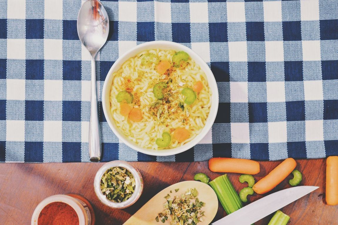 Warming up with chicken noodle soup. Bowl Healthy Eating Checked Pattern Spoon Vegetable Freshness Tablecloth Food And Drink Carrot High Angle View Ready-to-eat Indoors  Parsley Table No People Breakfast Close-up Food Salad Bowl Broccoli Blue And White Plaid Plaid Bowl Of Soup Chicken Noodle Soup Soup