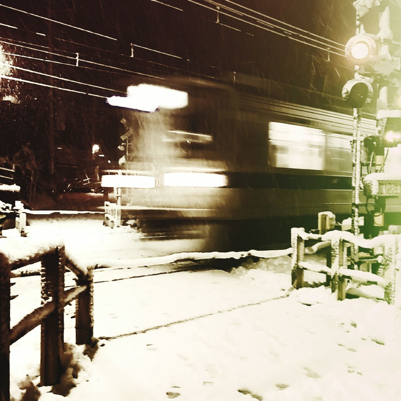 winter, snow, cold temperature, train - vehicle, weather, rail transportation, transportation, night, illuminated, mode of transport, public transportation, no people, outdoors, motion, railroad track, snowing, nature