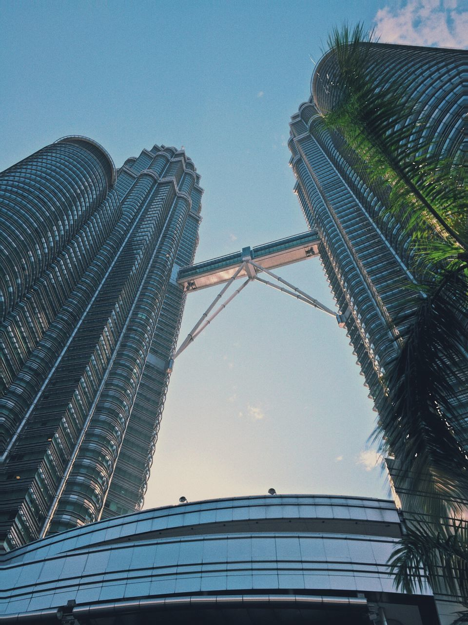 low angle view, architecture, built structure, building exterior, tall - high, clear sky, modern, skyscraper, tower, city, office building, blue, sky, tall, day, outdoors, capital cities, no people, building, travel destinations