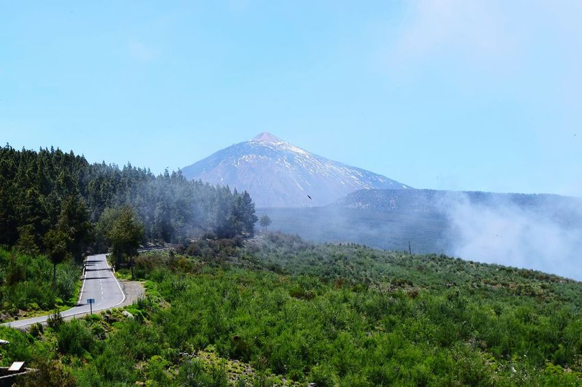 Nature Landscape Mountain Blue Water Scenics Sky No People Snow Outdoors Beauty In Nature Tree Night Teide National Park Volcano Beauty In Nature Tenerife Day Tree Nature Clear Sky Cloud - Sky Travel Destinations Over The Clouds