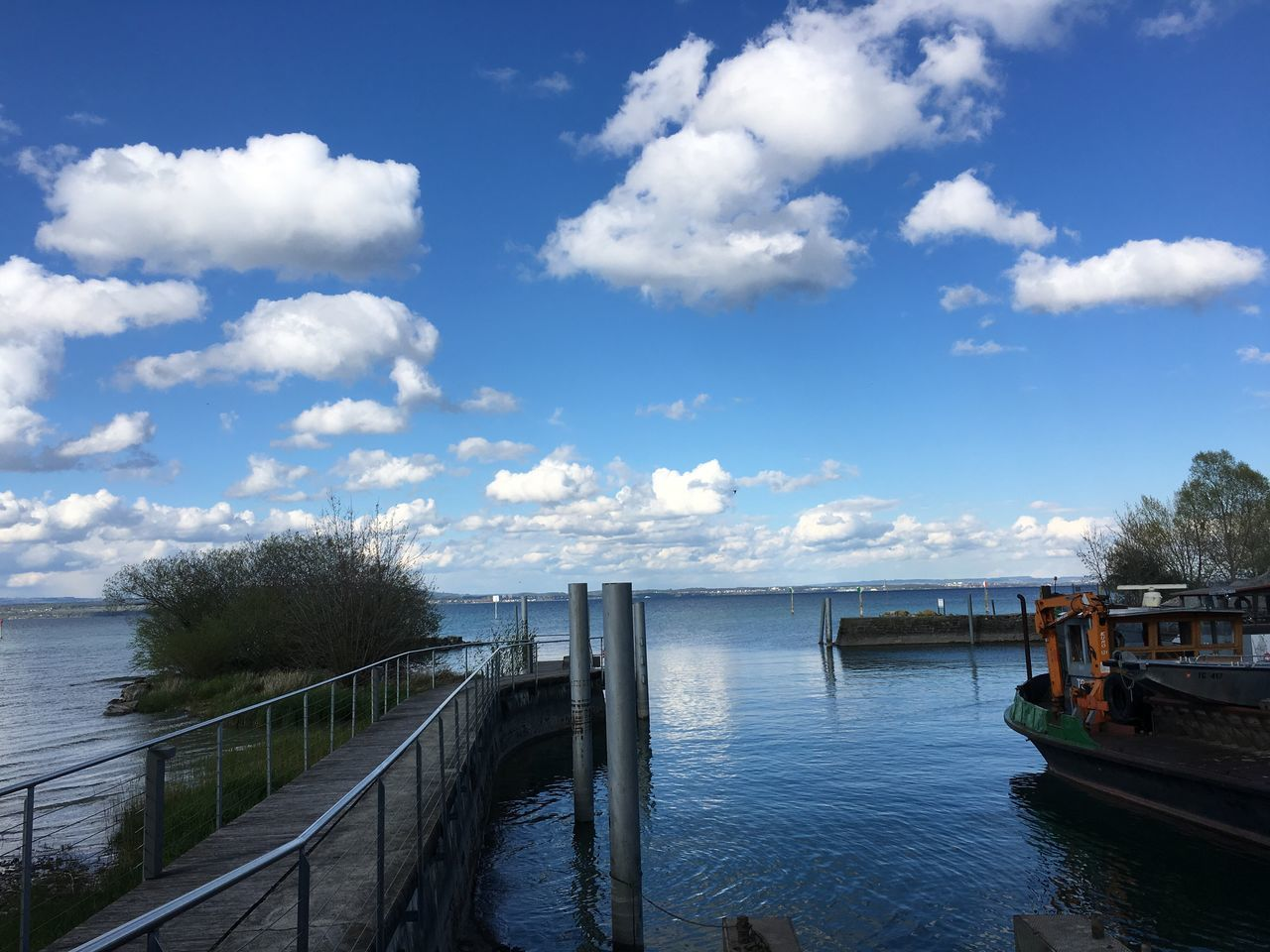 water, cloud - sky, sky, day, railing, nature, sea, scenics, tranquility, tranquil scene, outdoors, beauty in nature, no people, built structure, nautical vessel, tree, horizon over water, architecture