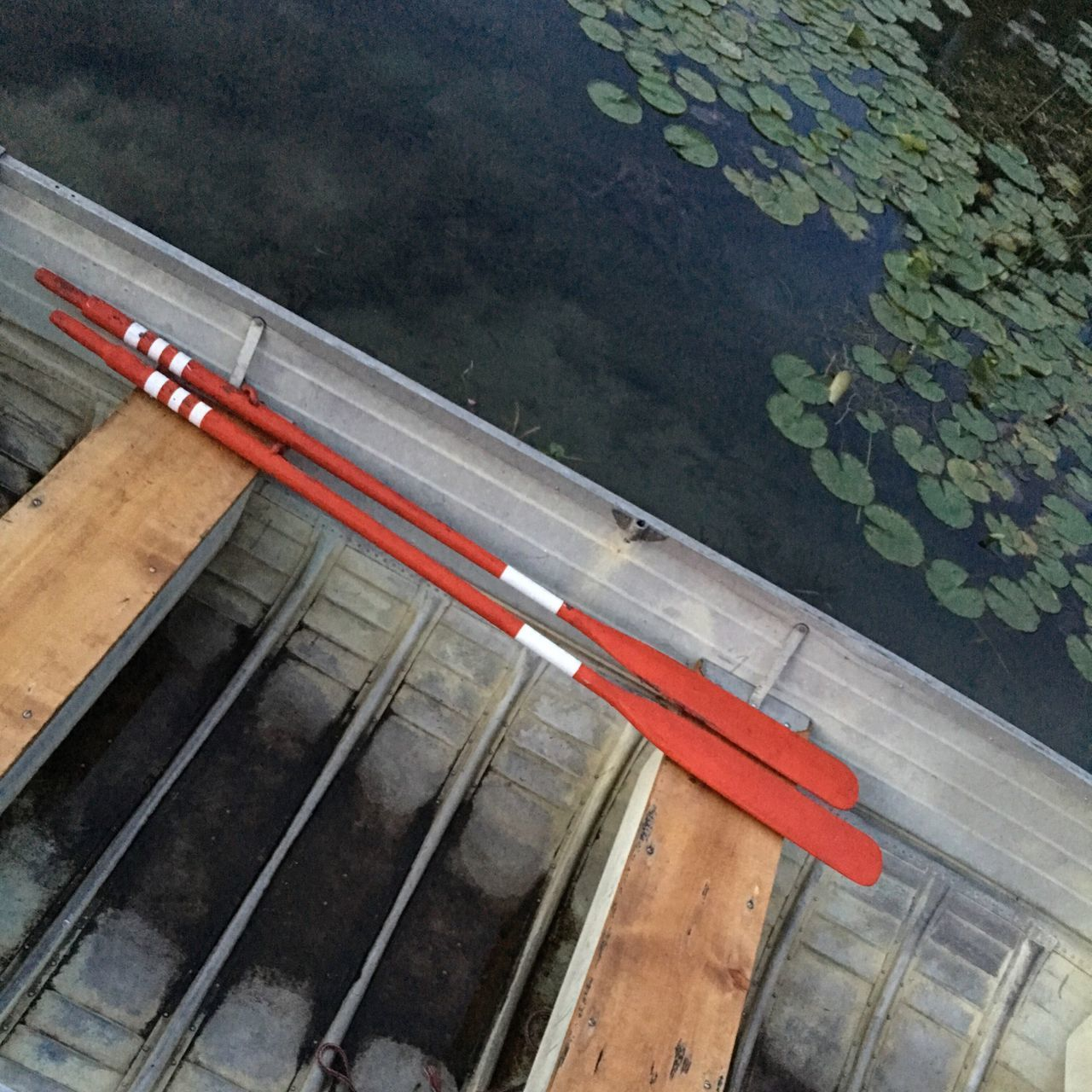 High Angle View Of Oars In Canoe On Lake