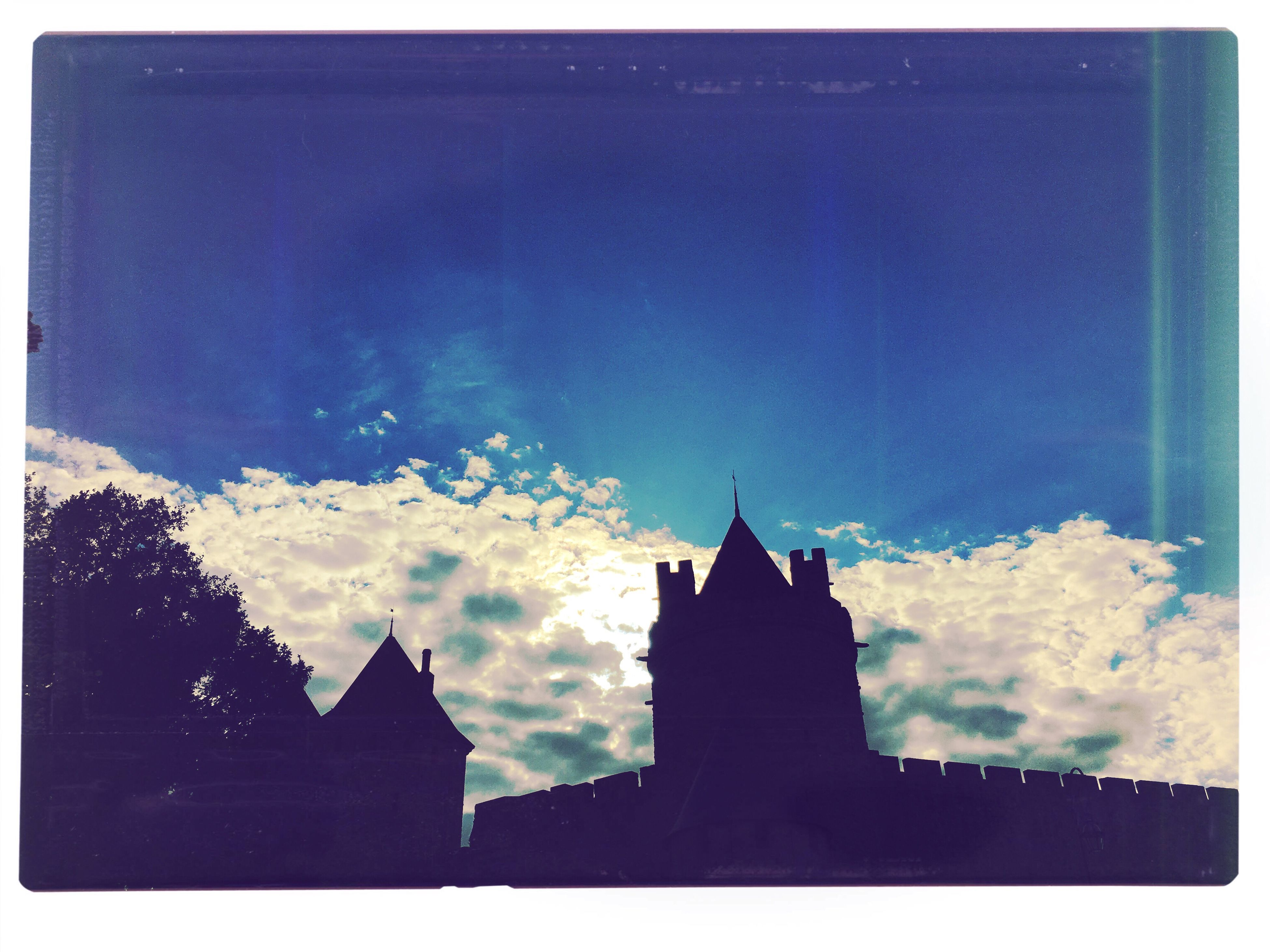 architecture, auto post production filter, built structure, transfer print, silhouette, building exterior, outline, low angle view, sky, blue, outdoors, cloud, high section, no people, place of worship, steeple, cloud - sky