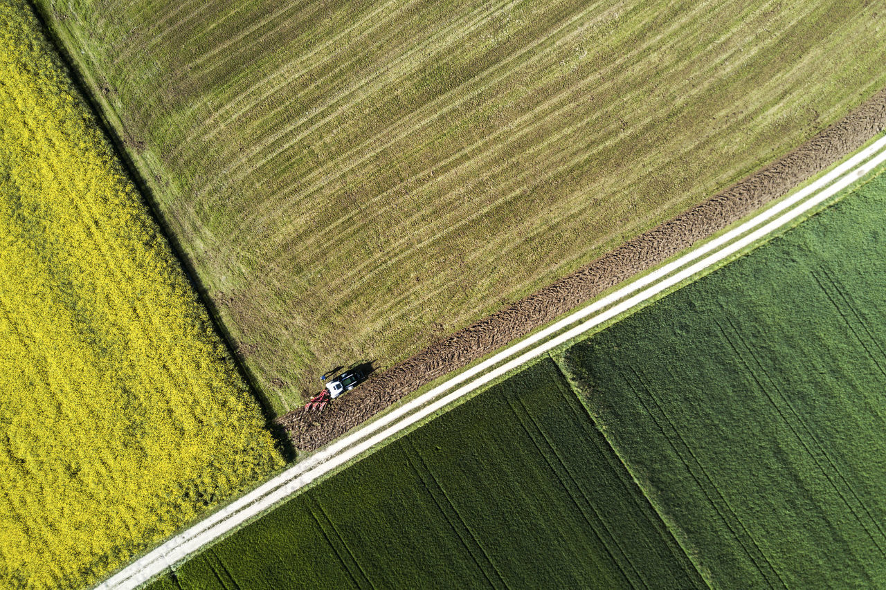 Agriculture Crop  Dronephotography Farm Farmer Field Green Color Growth High Angle View Nature Occupation Outdoors Rural Scene Tractor Working
