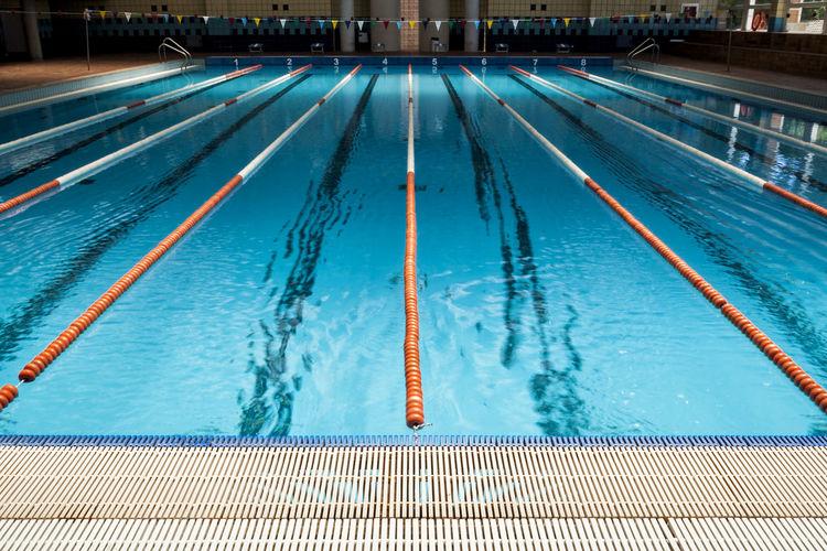 swimming pool 34 blue blue color blue water buoys diminishing perspective lane laneway laneways large group - Olympic Swimming Pool Lanes