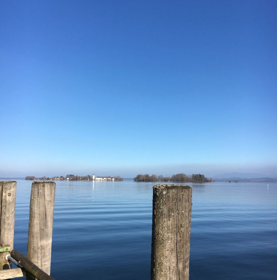 Blue Water Copy Space Nature Day No People Outdoors Clear Sky Wooden Post Beauty In Nature Scenics Tranquility Sea Built Structure Architecture Sky Fraueninsel