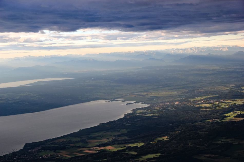 A Bird's Eye View Water Scenics Tranquil Scene Tranquility Beauty In Nature Alps Mountain View Ammersee Lake Lake View Cloud - Sky Idyllic Sea Sky Nature Mountain Coastline Majestic Mountain Range Remote Non-urban Scene Outdoors Day Seascape