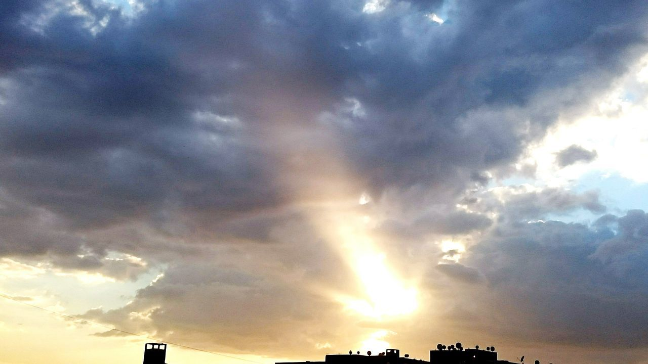 cloud - sky, sky, low angle view, sunbeam, silhouette, atmospheric mood, dramatic sky, beauty in nature, no people, nature, scenics, sunset, outdoors, tranquility, tranquil scene, storm cloud, sky only, backgrounds, day