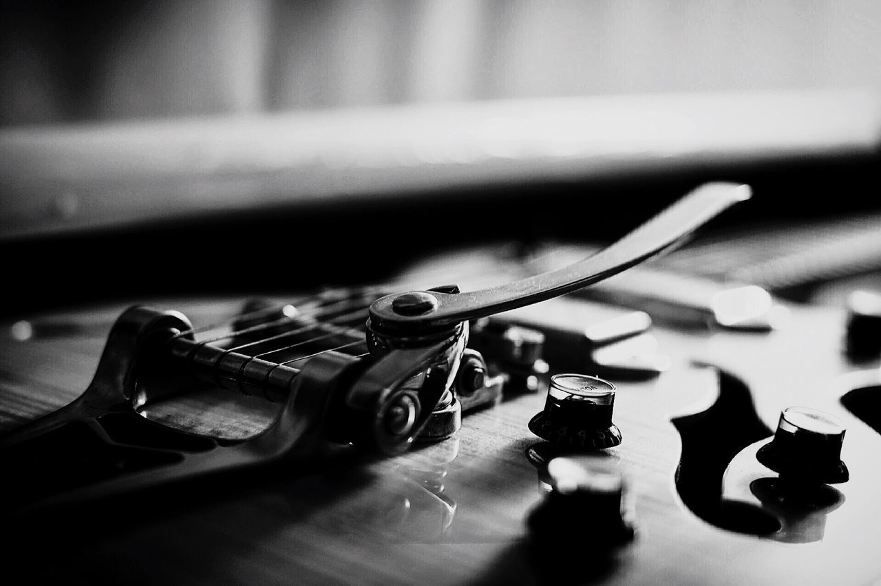 indoors, table, music, no people, close-up, arts culture and entertainment, musical instrument, weapon, musical instrument string, bullet, day, chess piece