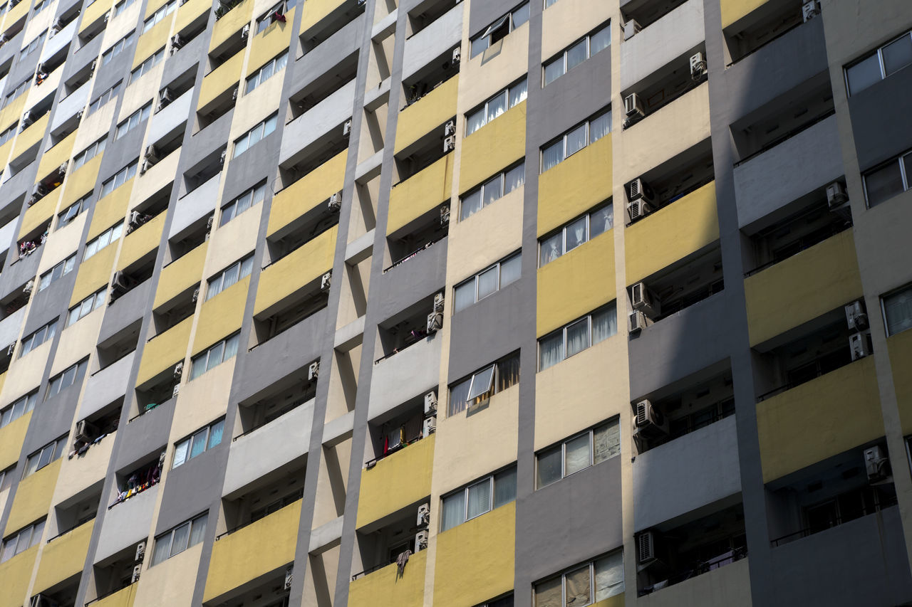 Apartment Architecture Backgrounds Building Exterior Built Structure City Day Full Frame In A Row Low Angle View Modern No People Outdoors Pattern Repetition Residential  Skyscraper Window Yellow