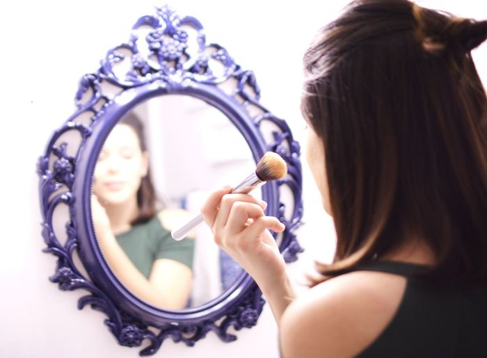 Woman putting on makeup One Person People Makeup Putting On Makeup Mirror Makeup Brush Woman Looking In The Mirror first eyeem photo