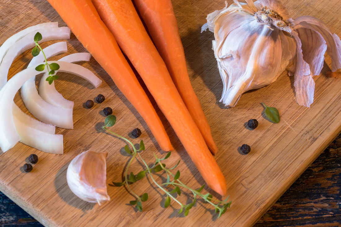 Raw vegetables for cooking Carrots Close-up Clove Clover Cutting Board Food Garlic Healthy Eating Herb Ingredient Ingredients Onion Peppercorns Raw Food Thyme Vegetable White