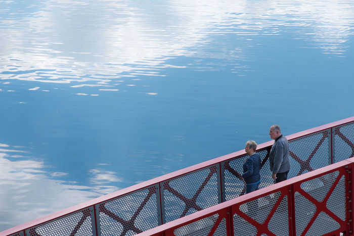 Beauty In Nature Branch Bridge Bridge - Man Made Structure Couple Day Fishing Pole Full Length High Angle View Lake Leisure Activity Lifestyles Men Nature Outdoors People Railing Real People Reflection Reflections Sea Standing Togetherness Two People Water