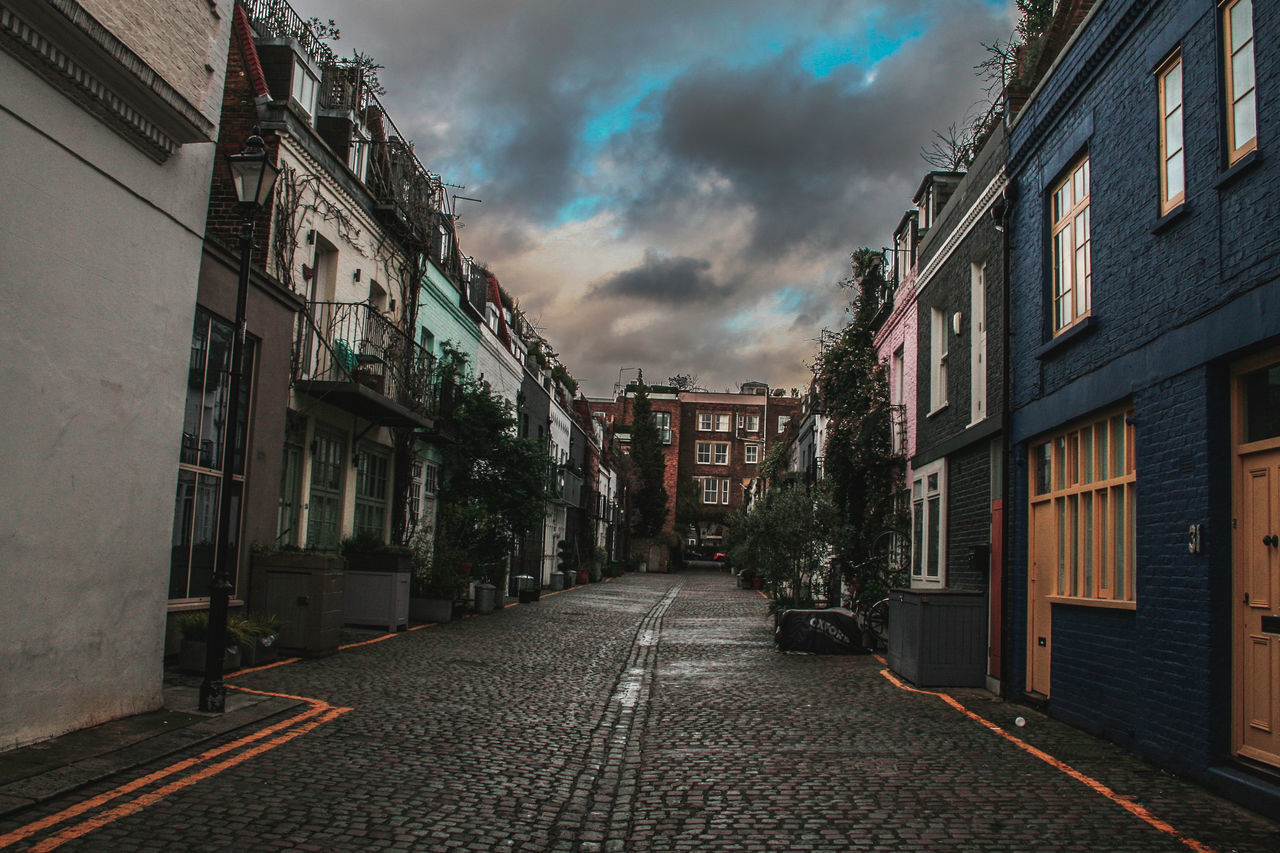 building exterior, architecture, built structure, cloud - sky, sky, street, the way forward, outdoors, residential building, no people, city, day, road, storm cloud