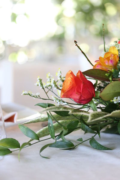 Close up of a floral bouquet as a centrepiece on a table Bouquet Bouquet Of Flowers Centerpiece Centrepiece Close-up Day Flower Flower Head Flowers Freshness No People Orange Rose Outdoors Red Rose Roses Wedding