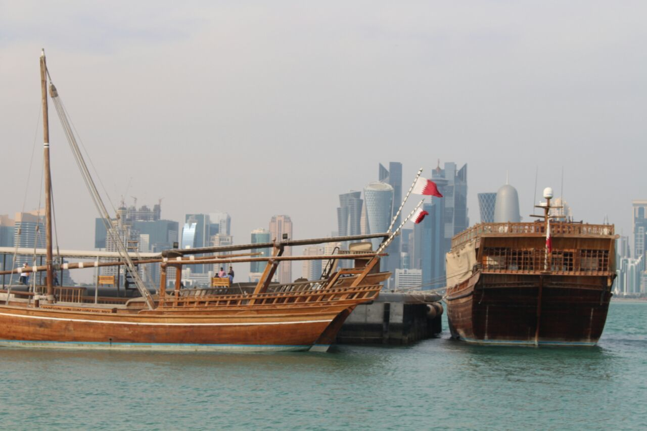 nautical vessel, waterfront, transportation, architecture, water, skyscraper, building exterior, sea, mode of transport, built structure, ship, day, harbor, no people, outdoors, sky, city, sailing, urban skyline, cityscape, nature, sailing ship