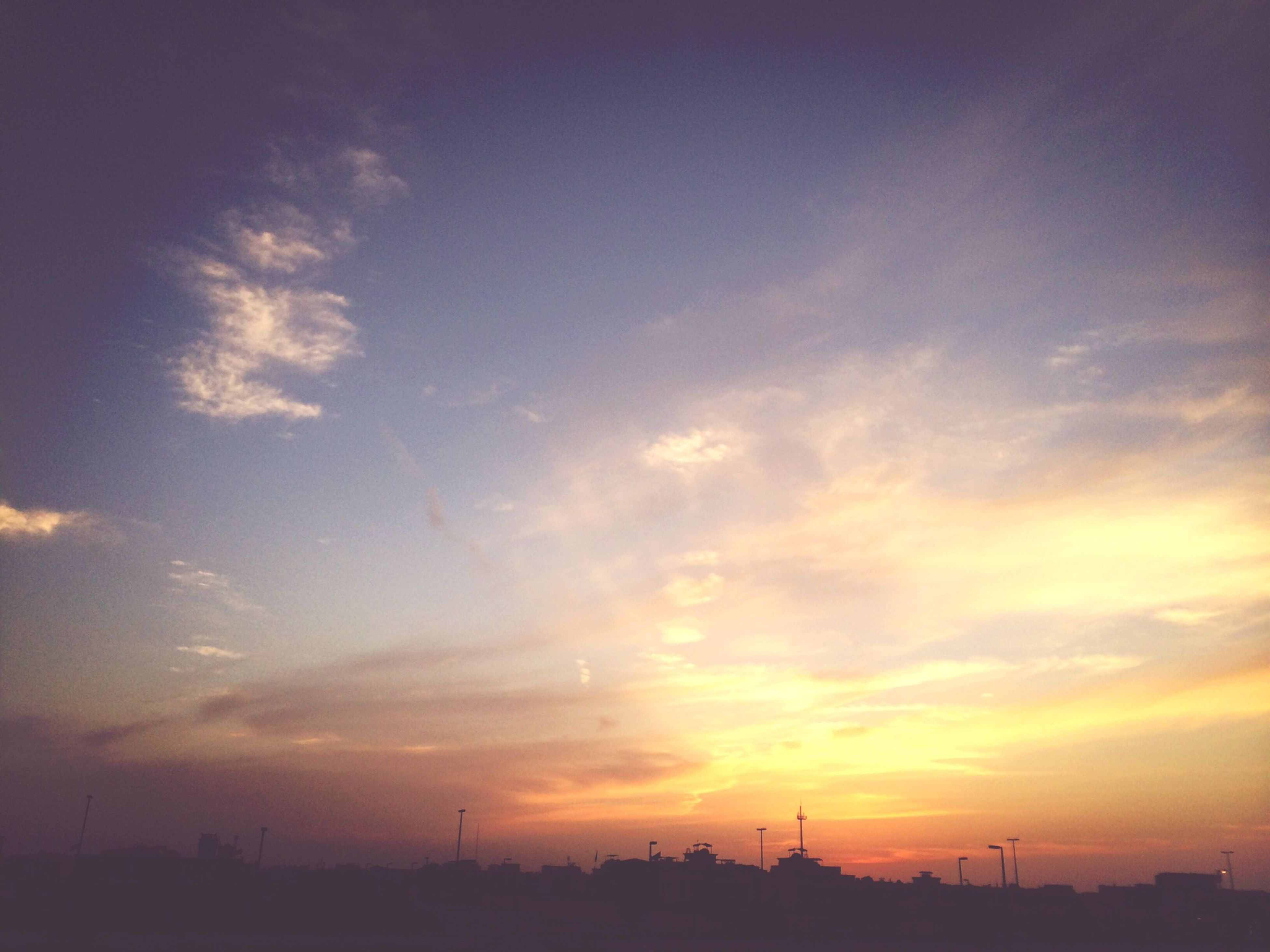sunset, silhouette, sky, scenics, tranquil scene, tranquility, beauty in nature, landscape, orange color, nature, cloud - sky, idyllic, cloud, outdoors, field, no people, dramatic sky, dusk, low angle view, non-urban scene