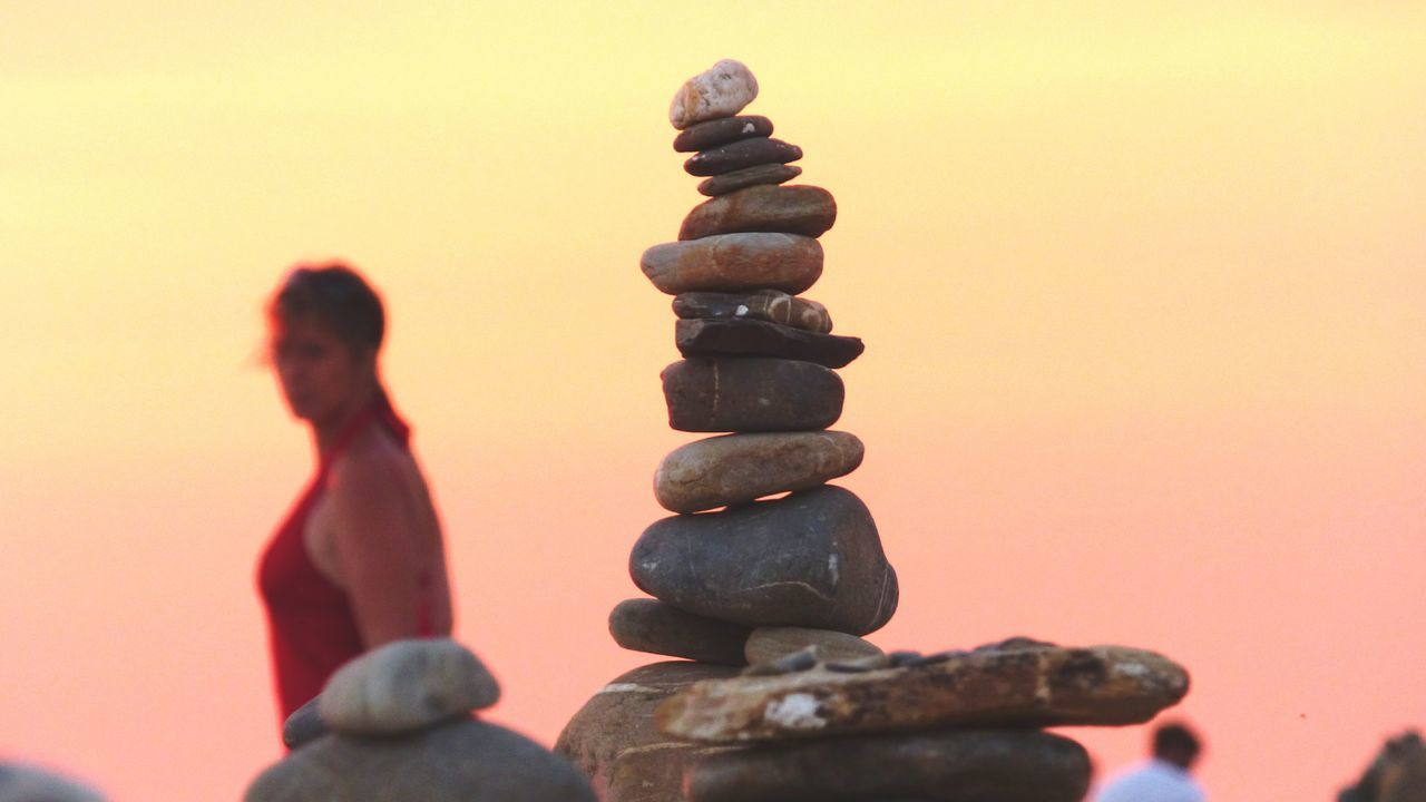 EyeEm Selects In A Row Colored Background Stack Balance Rock - Object Rock Formation Praia Do Farol Milfontes Stability Zen Rock On Beach Zen Rock At Sunset Woman In Red Red Sunset Outdoors Representing Nature