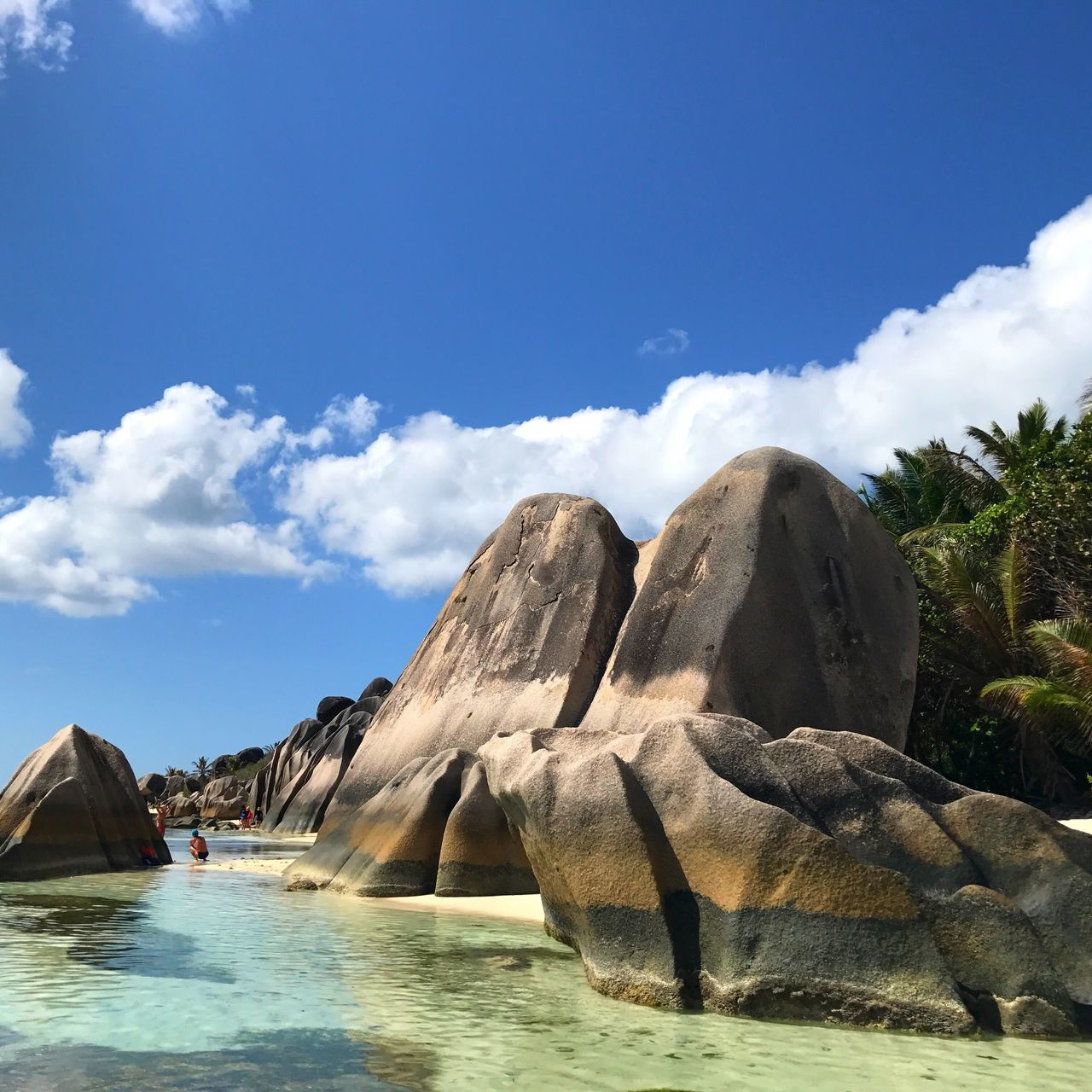 Water Sky Tranquil Scene Day Nature Cloud - Sky Blue Waterfront Natural Landmark Rock Formation Non-urban Scene Seychelles La Digue