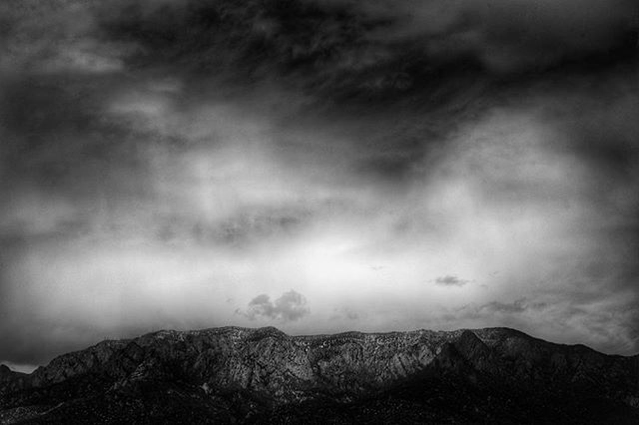 Late April storm clouds over Sandia Crest. Processed with Snapseed Spring Storm Weather Sandia Nmlife DSLR Nikon D700