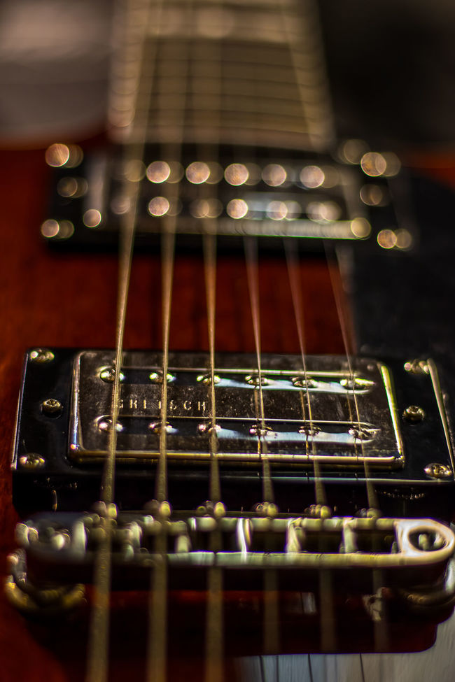 A studio shot , part of a guitar, showing depth and dimension, wires, bodies and pick-ups. Abstract Photography Arts Culture And Entertainment Close-up Depth Of Field Depthoffield Electric Guitar Extreme Close-up Full Frame Guitar Hobbies In A Row Indoors  Knob Music Musical Instrument Repetition Selective Focus Single Object String String Instrument Studio Photography Studio Shot