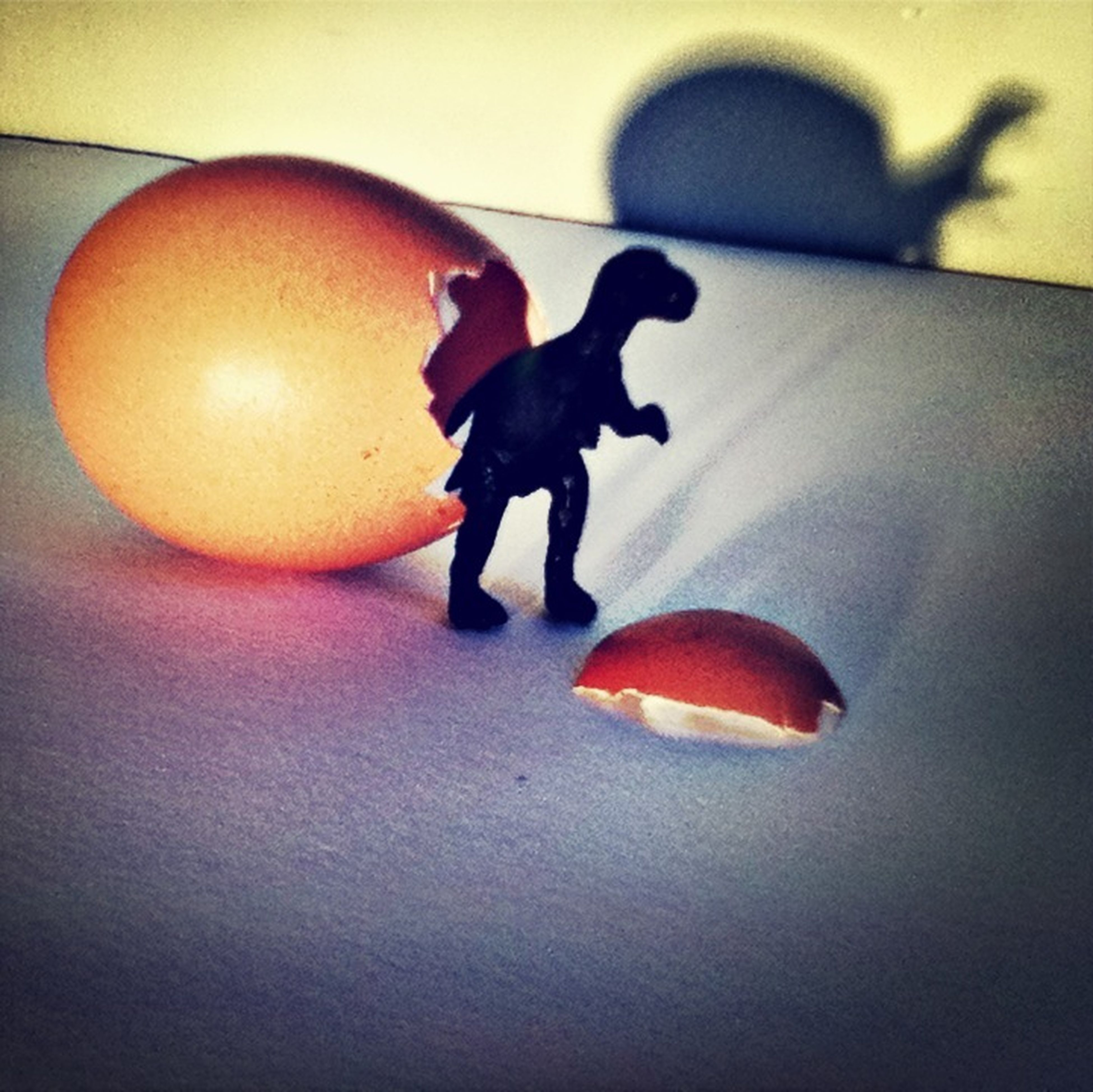 indoors, animal representation, toy, full length, high angle view, human representation, art and craft, art, creativity, animal themes, red, flooring, orange color, auto post production filter, shadow, ball, table, sport, mid-air, no people