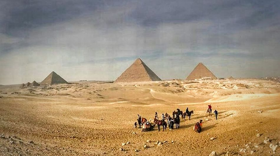 Desert Pyramid History Travel Destinations Ancient Outdoors Cloud - Sky Sand Domestic Animals People Sky Ancient Civilization Cultures Building Exterior Built Structure Architecture Egyptphotography Giza Nature Egypt Giza Pyramids Cairobeauty Cairo Egypt Pharoah Pharaonic Civilization