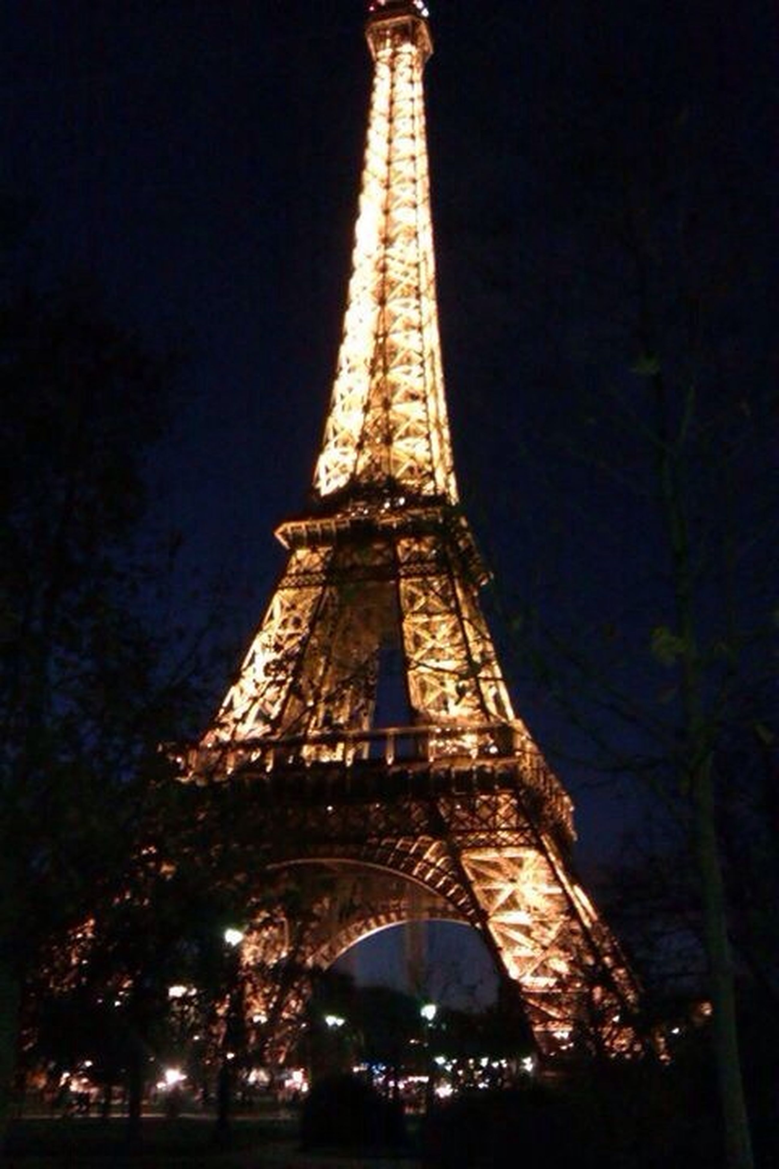 architecture, built structure, eiffel tower, night, international landmark, famous place, travel destinations, illuminated, tower, capital cities, tall - high, tourism, travel, city, building exterior, low angle view, sky, culture, metal, engineering