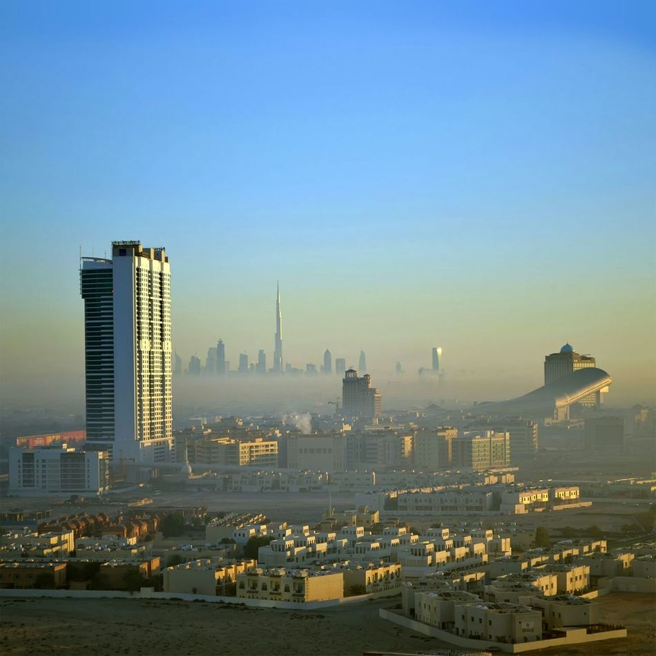 View on Mall Of The Emirates and Fogged Burj Khalifa from Tecom