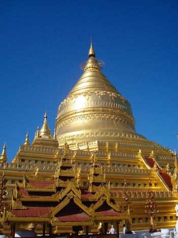 Architecture Blue Building Exterior Built Structure Clear Sky Day Gold Gold Gold Colored Golden Pagoda Low Angle View Myanmar Pagoda No People Outdoors Pagoda Place Of Worship Religion Sky Spirituality Travel Destinations