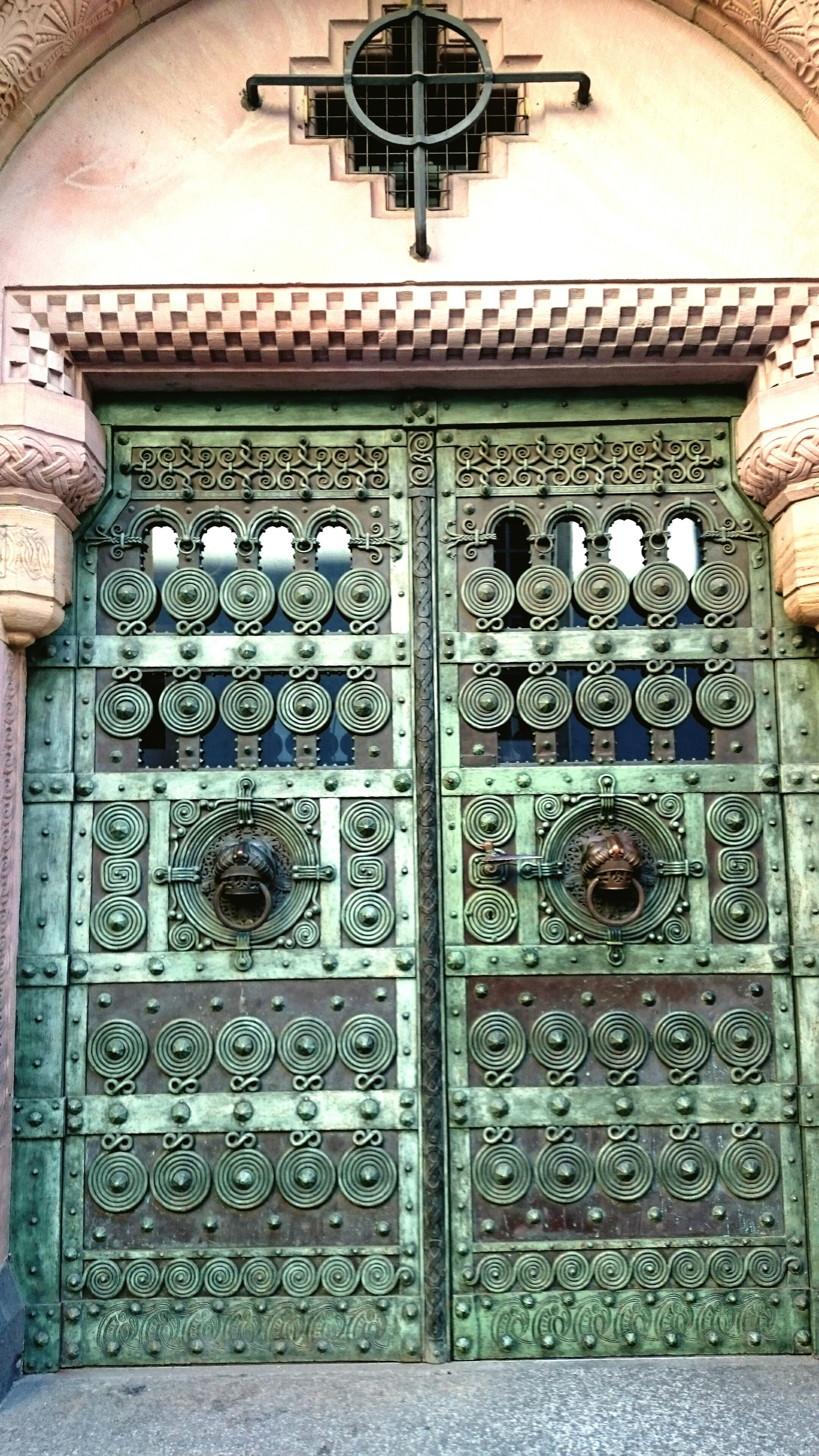 old, indoors, text, religion, old-fashioned, metal, wood - material, architecture, built structure, antique, communication, close-up, hanging, wall - building feature, door, history, the past, ornate, spirituality, number
