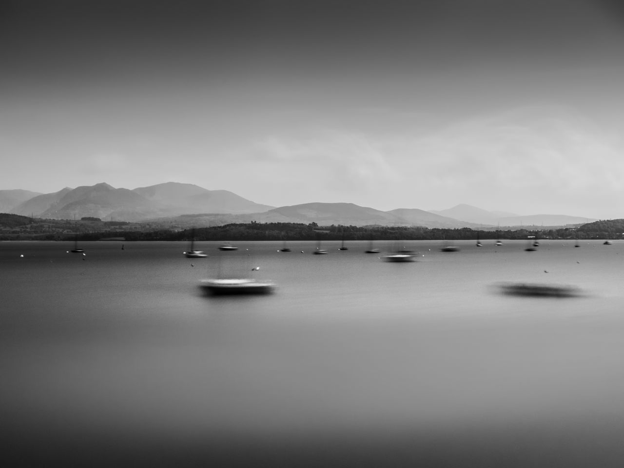 At Anchor, Beaumaris, Anglesey. Beauty In Nature Calm Cloud Cloud - Sky Cloudy Day Idyllic Landscape Mountain Mountain Range Nature No People Non-urban Scene Ocean Outdoors Overcast Remote Rippled Scenics Sky Tranquil Scene Tranquility Water The Great Outdoors - 2016 EyeEm Awards The Great Outdoors With Adobe