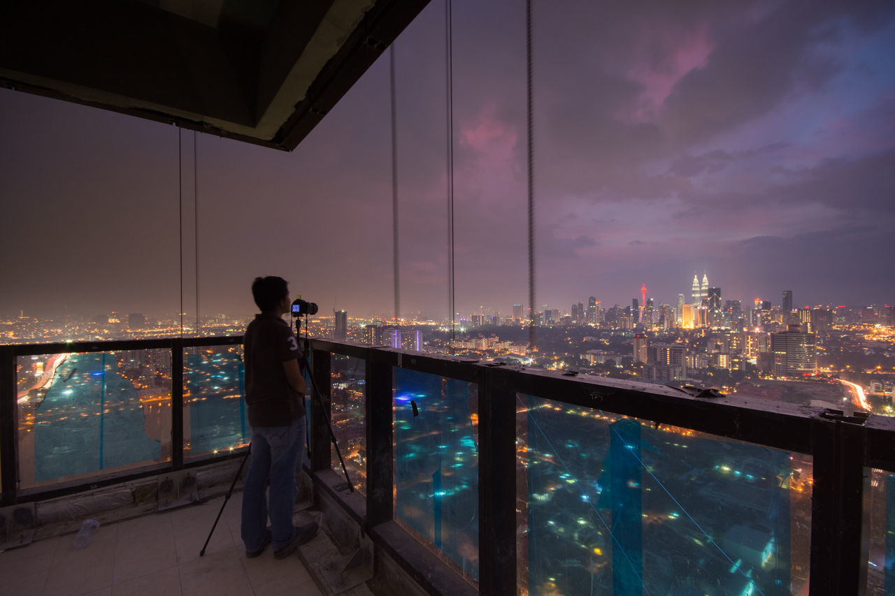 Man Photographing Cityscape
