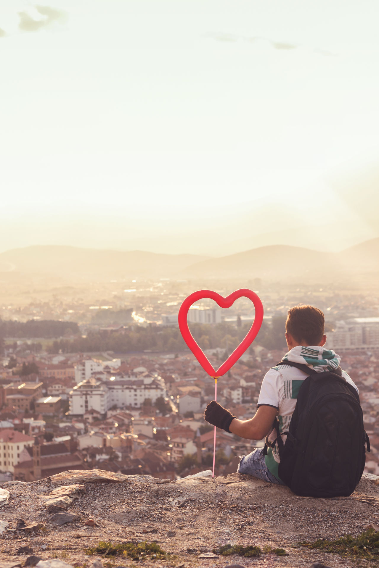 longing for the city Alone Aspiration Backpack Beauty In Nature Boy Building Exterior Enjoying The Sun Heart Kosova Kosovo Leisure Activity Lifestyles Longing Love Nature Outdoors Prizren Rooftop Sitting Sky Summer Sunlight Sunset Warm