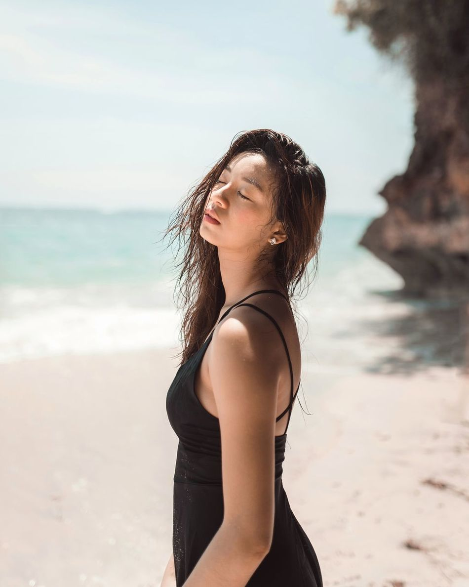 daughter of suns One Woman Only Beach Sea Summer Outdoors Beautiful Woman Beautiful People Portrait Of A Woman Portraits Of EyeEm Women Around The World Beauty In Nature Long Goodbye EyeEm Diversity The Secret Spaces Clear Sky Light Light Collection