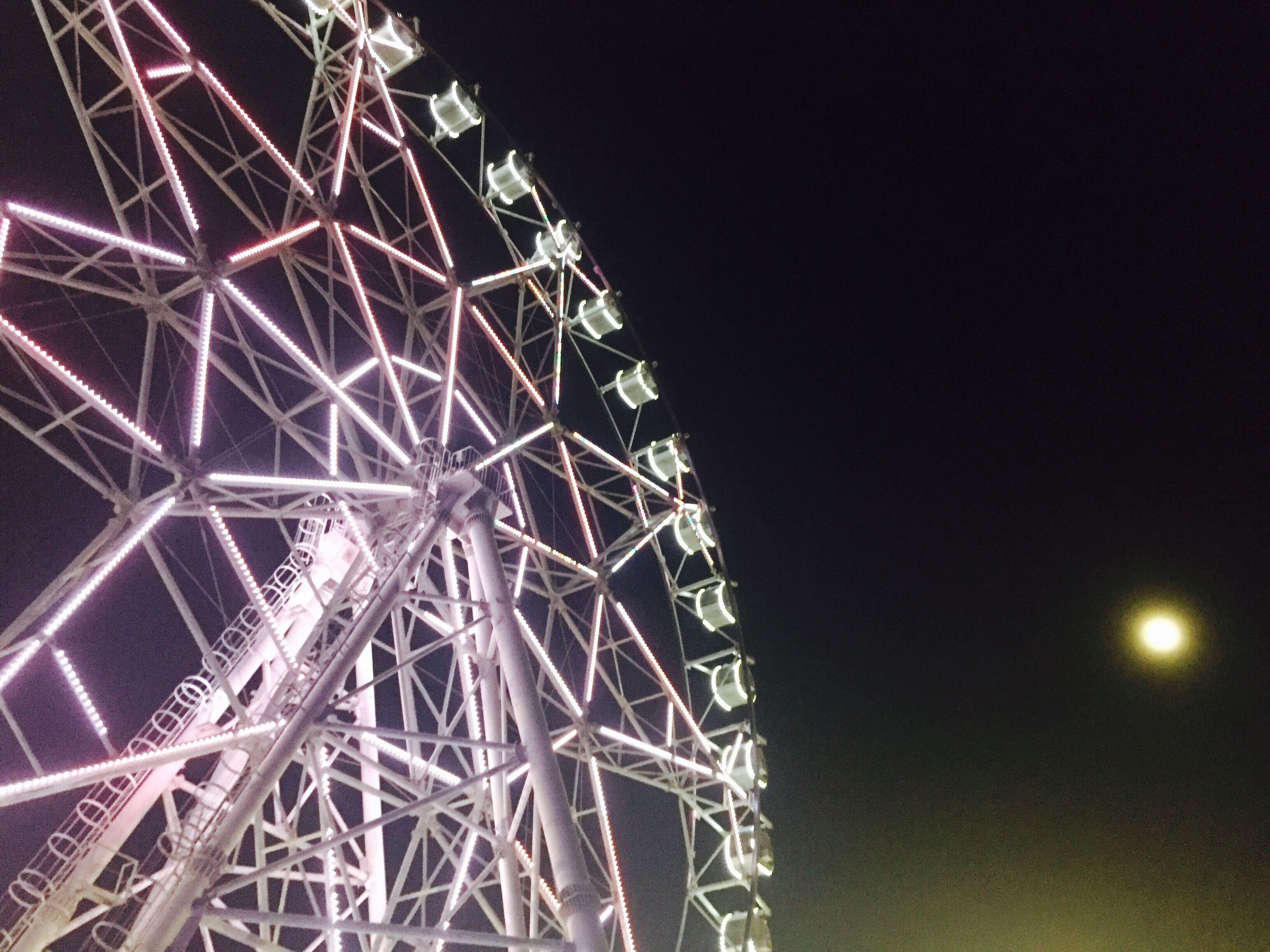 night, low angle view, illuminated, sky, amusement park ride, arts culture and entertainment, outdoors, no people, tall - high, glowing, dark