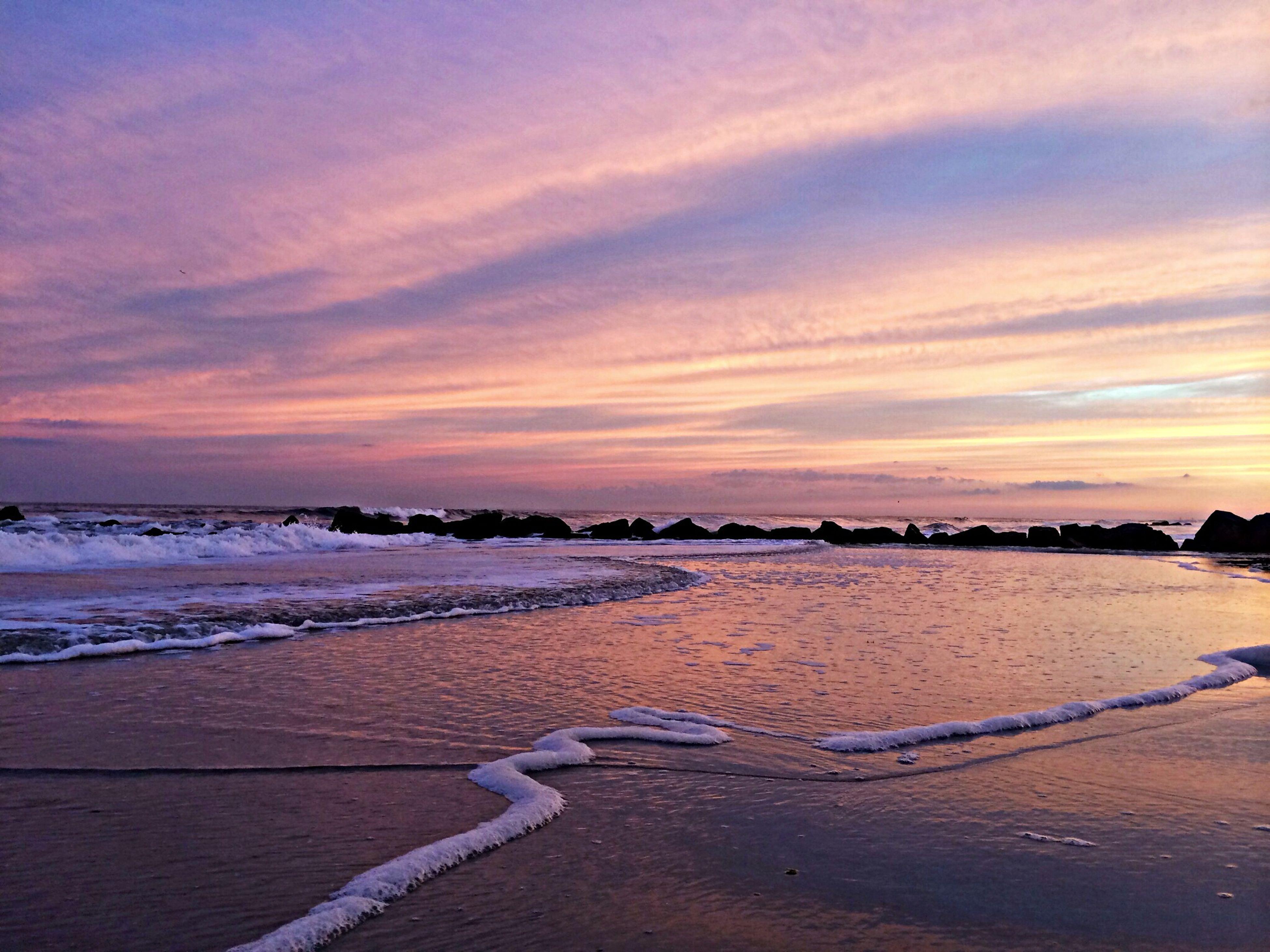 sunset, beach, sea, water, sky, scenics, tranquil scene, shore, tranquility, beauty in nature, sand, orange color, cloud - sky, nature, idyllic, horizon over water, outdoors, cloud, coastline, non-urban scene