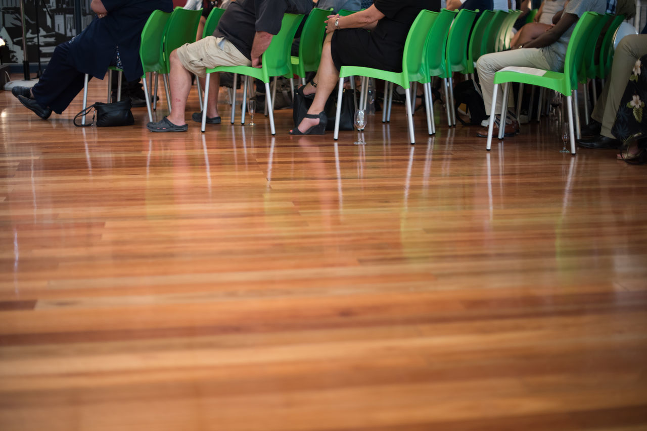 indoors, table, hardwood floor, sitting, chair, low section, day, real people