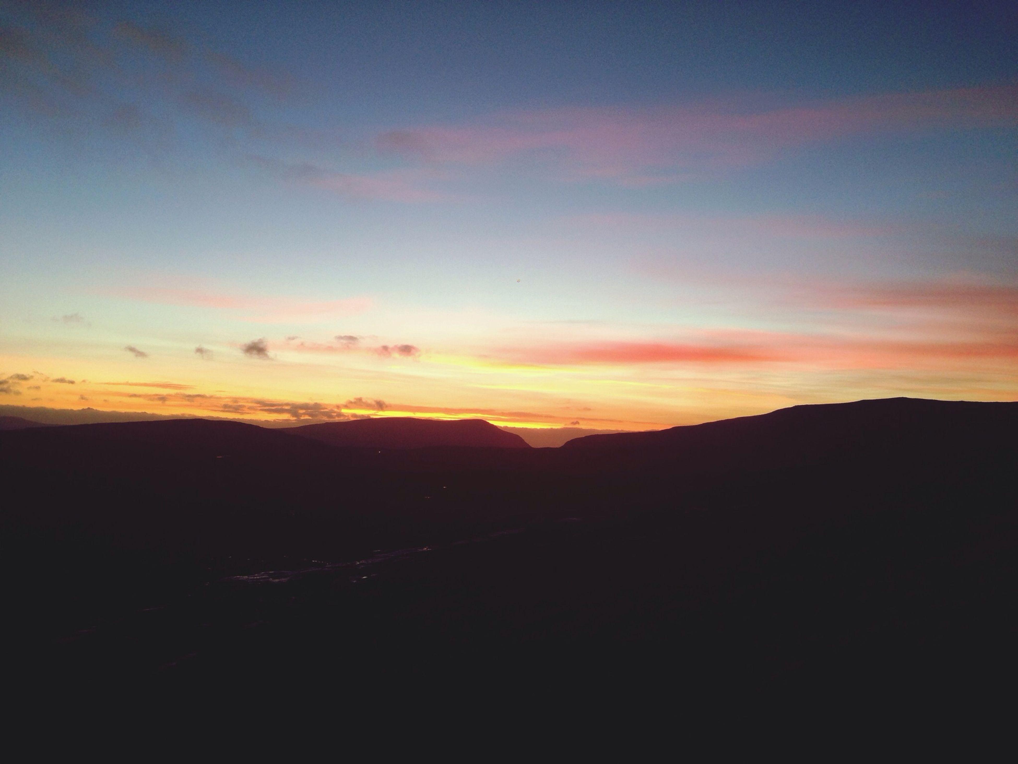 sunset, silhouette, scenics, tranquil scene, tranquility, beauty in nature, sky, mountain, landscape, nature, idyllic, orange color, mountain range, cloud - sky, dusk, cloud, dark, non-urban scene, outdoors, copy space