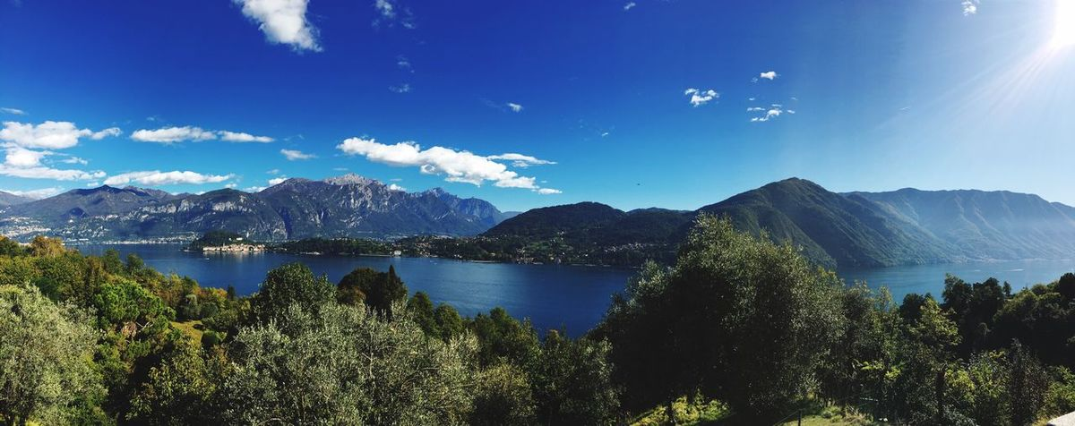 Lake of Como EyeEm Selects Mountain Beauty In Nature Scenics Nature Tranquil Scene Tranquility Sky Water Tree Blue Mountain Range Sunlight Outdoors Lake Day
