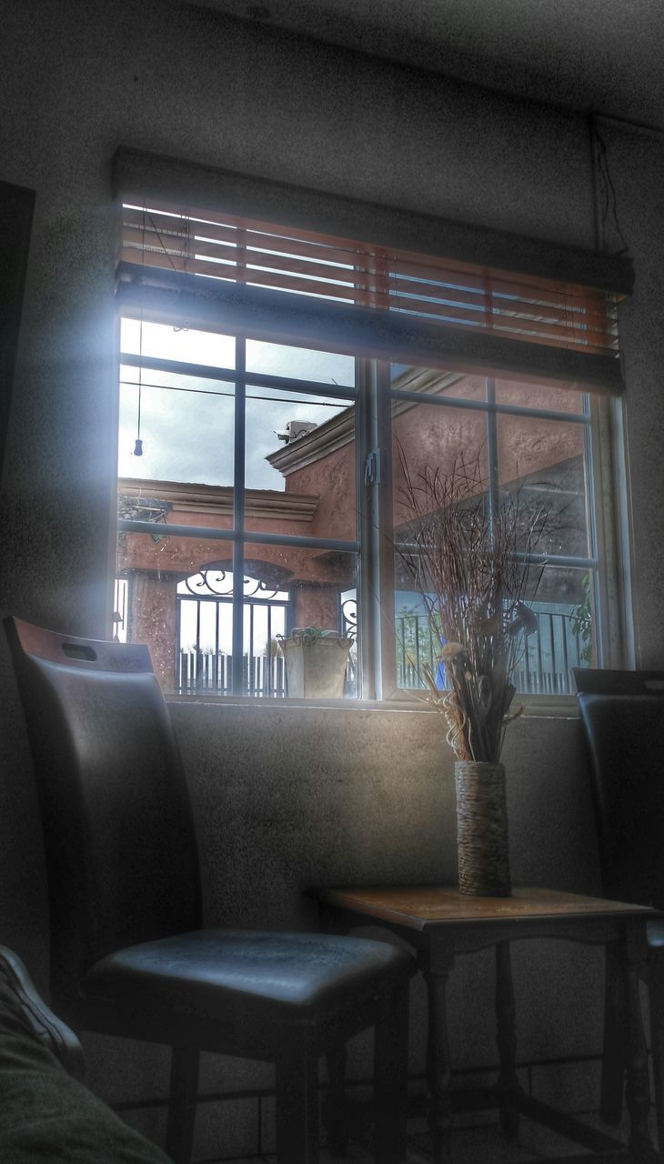 window, indoors, chair, home interior, absence, table, no people, curtain, day, furniture, seat, home showcase interior, architecture
