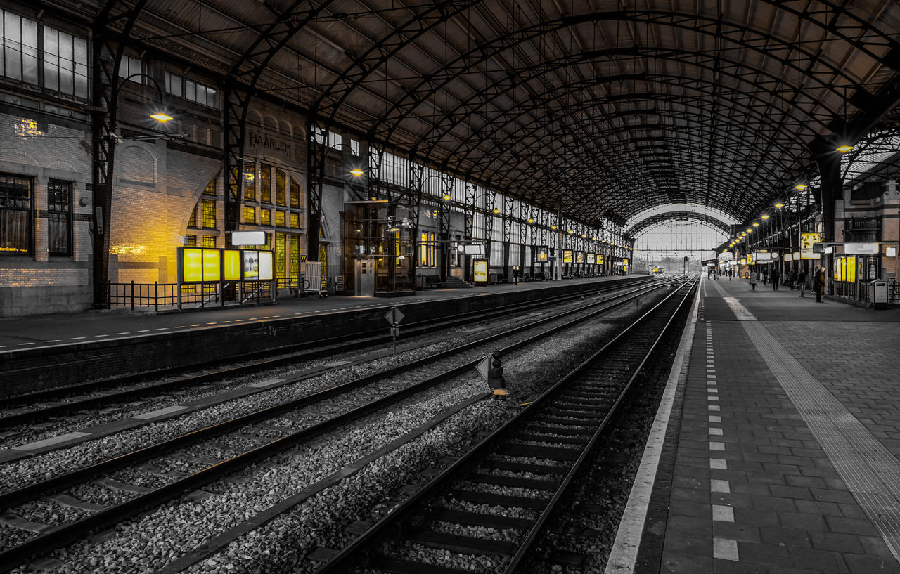 Haarlem central station, one of the oldest station of The Netherlands Composition Haarlem Haarlem Central Station Railroad Station Railroad Station Platform Railroad Track Train Station Transportation First Eyeem Photo