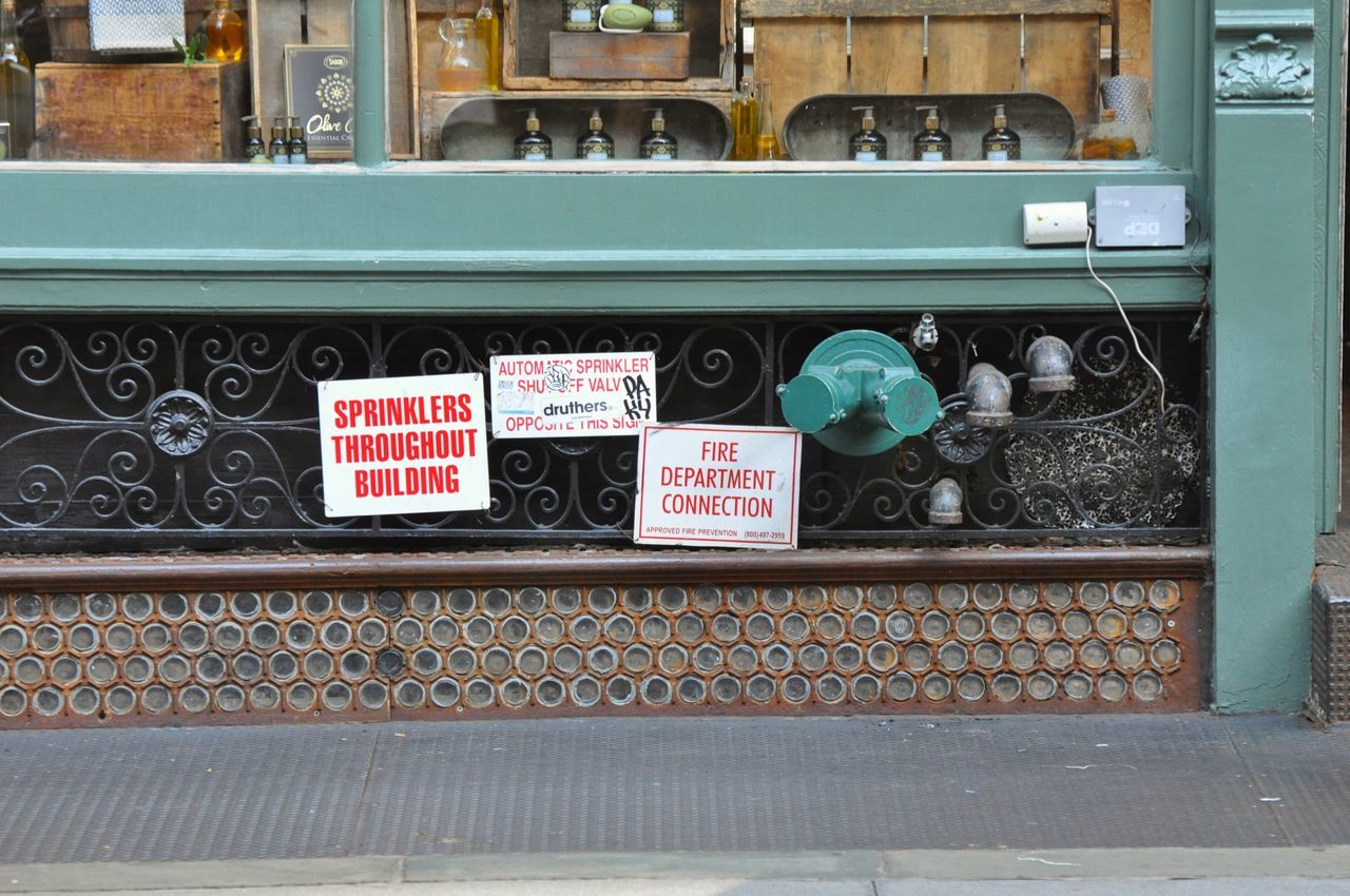 Retail  Store No People Variation Day Text Outdoors Signs Sprinkler Green Detail Urban Geometry Chelsea New York Manhattan