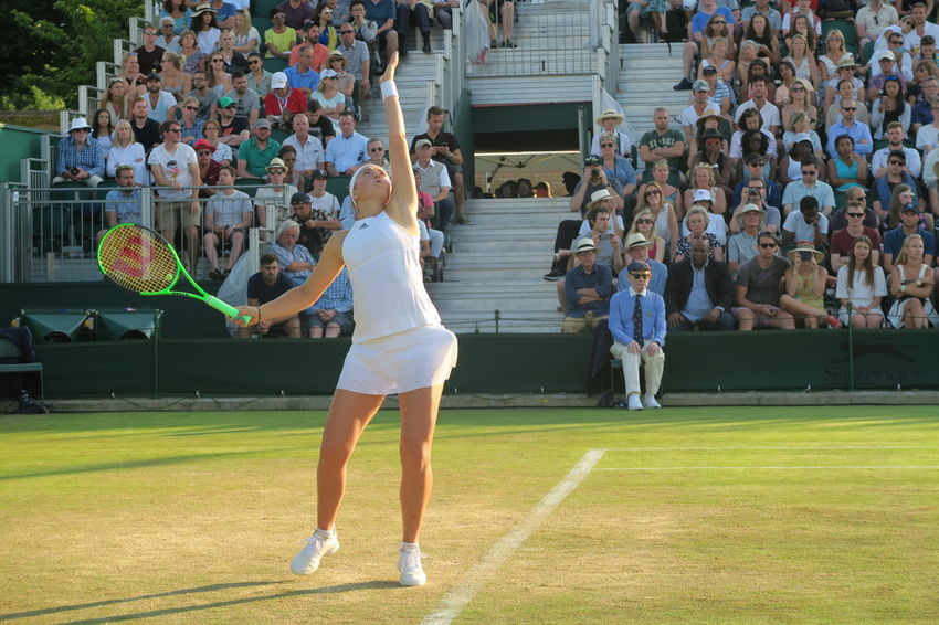 French open Champion Jelena Ostapenko serving at the Wimbledon Championships Adult Audience Crowd Full Length Jelena Ostapenko Leisure Activity Outdoors People Playing Real People Serve Sport Sportswoman Standing Tennis Tennis Ball Tennis Court Tennis Racket Tennis Racquet Tennis 🎾 Tenniscourt Togetherness Watching Wimbledon Women