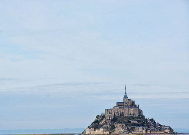And so his vision became reality and a fairy tale for us. Architecture Mount Bretagne Sky Abbey Abbaye Saint Michael's Mount Cathedral Church Bretagnetourisme Blue Sky Outdoors Historical Building History Mont Saint Michel Showcase: February Pastel Power Landscapes With WhiteWall Blue Wave