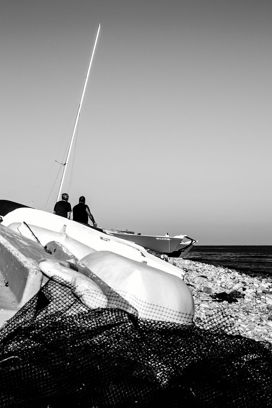 Fishing Fishing Boat Fishing Nets Sailor Life Real People Photography Themes Horizon Over Sea Blackandwhite Photography Tranquility El Campello Monochrome Photography Travel Destinations Horizon Over Water Nautical Sign Industrial Ship Ships At Sea Nautical Fishermenboat FisherMens SailorMars People Clear Sky Peaceful Place Sunlight Sea