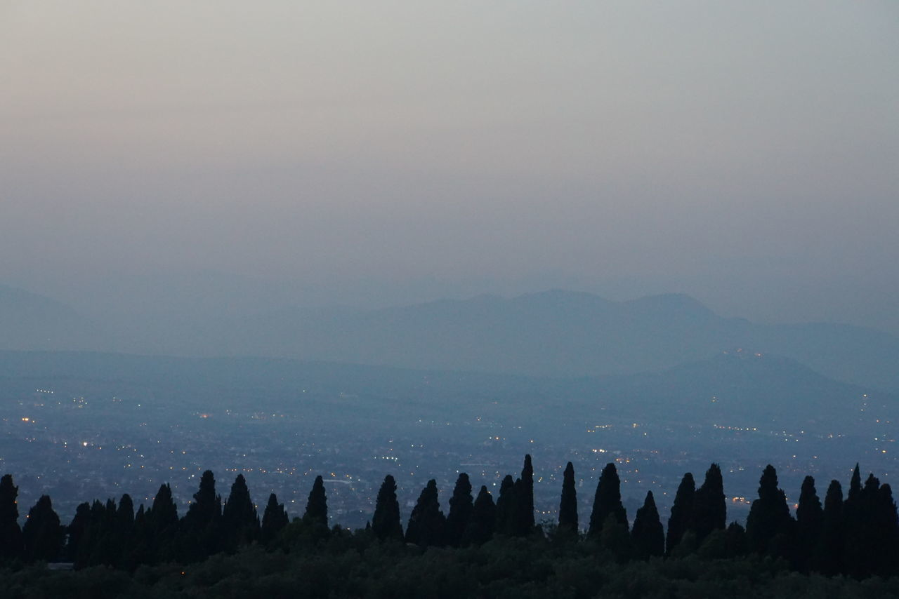at the golden hour enjoying a view over Rome from Tivoli Beauty In Nature Day Dusk Foggy Golden Hour Hazy  Horizon Over Water Majestic Mountain Mountain Range Nature No People Non-urban Scene Outdoors Panorama Remote Roma Rome Scenics Sky Solitude Tivoli Tranquil Scene Tranquility Valley